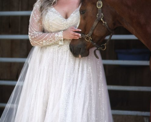 Beaded long sleeve gown