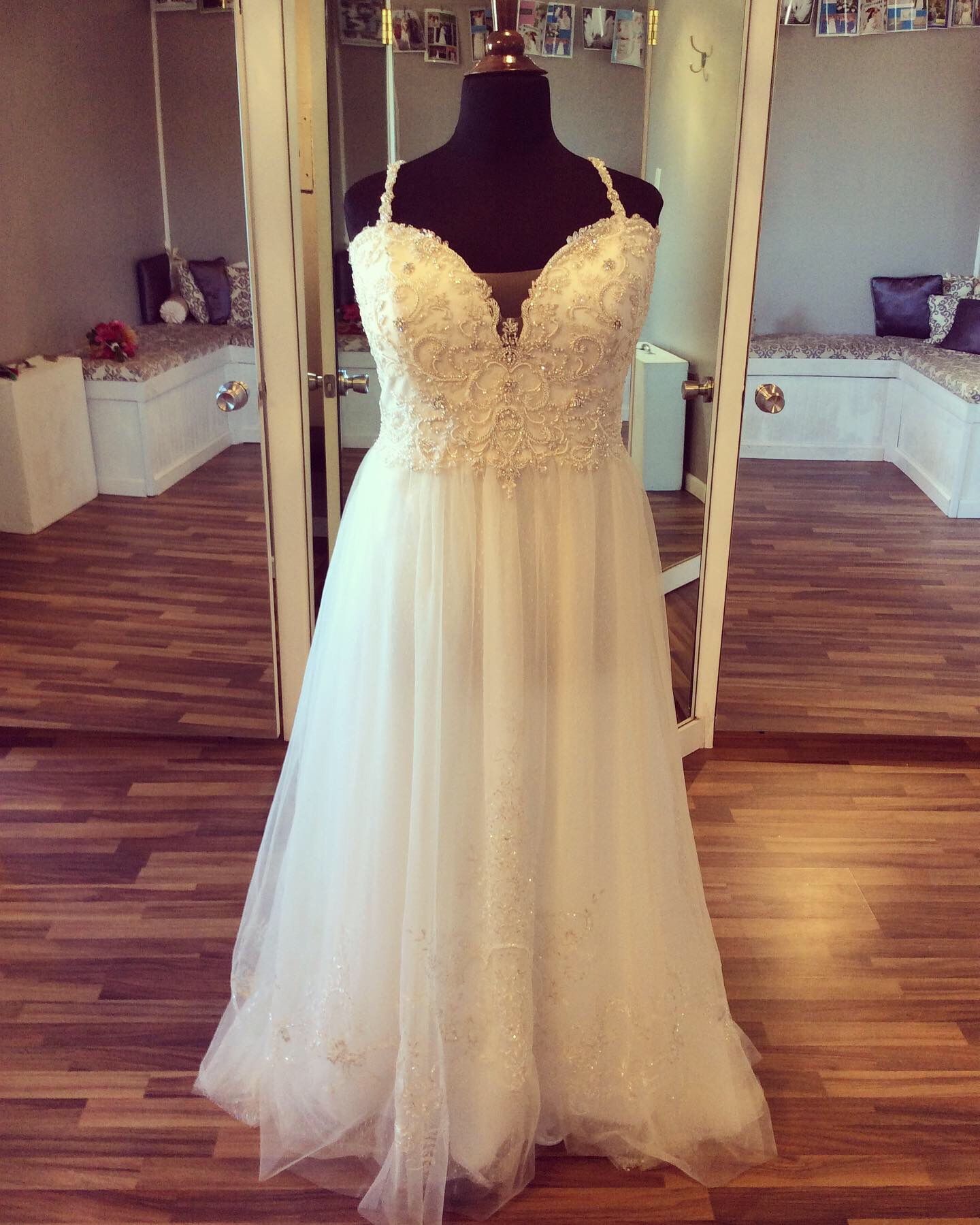 Beaded top bridal gown with straps