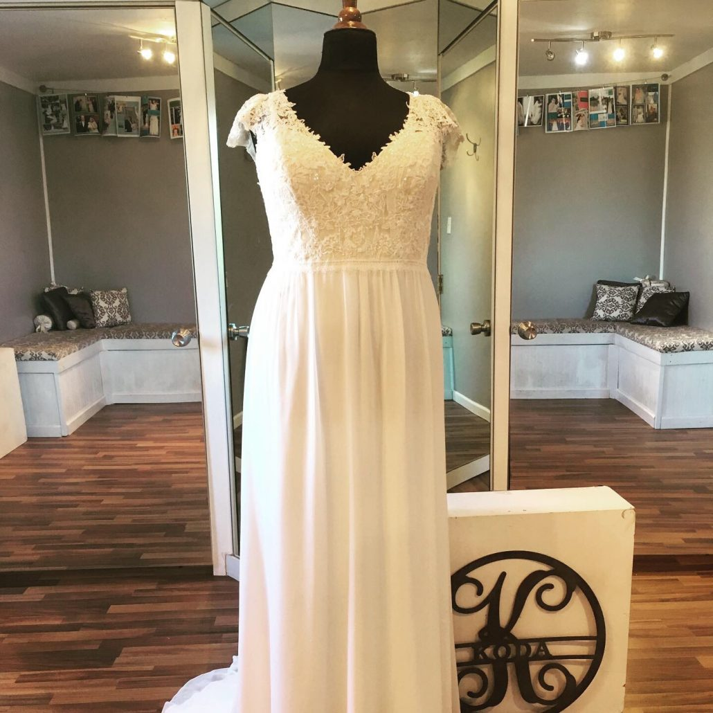 Chiffon bridal gown with lace cap sleeves